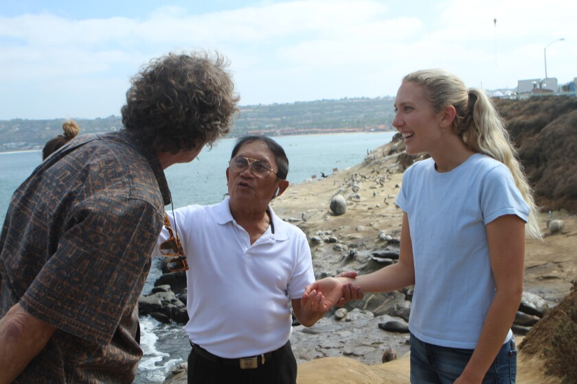 Koch and his daughter Emi (right) ask Pham about his life. Emi is a renown surfer, founder of an international coastal nonprofit, and National Geographic's 2018 Adventurer of the Year.