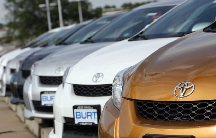2009 Matrix compact wagons sit at a Toyota dealership.