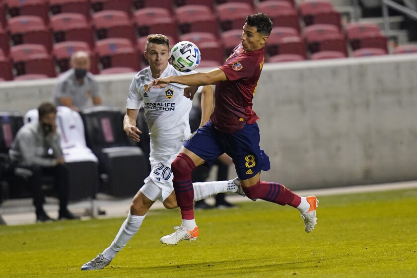 Real Salt Lake midfielder Damir Kreilach (8) and Los Angeles Galaxy forward Nick DePuy (20) battle for the ball in the first half during an MLS soccer match Wednesday, Sept. 23, 2020, in Sandy, Utah. (AP Photo/Rick Bowmer)