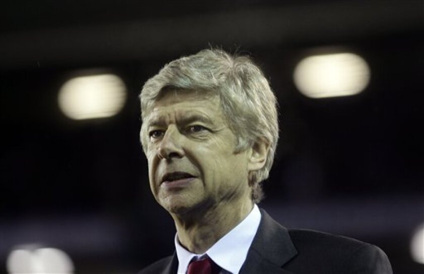 Arsenal manager Arsene Wenger looks on before the English Premier League soccer match against Birmingham City at St' Andrews stadium, Birmingham, England, Saturday, Jan. 1, 2011. (AP Photo/Simon Dawson) NO INTERNET/MOBILE USAGE WITHOUT FOOTBALL ASSOCIATION PREMIER LEAGUE (FAPL) LICENCE. CALL +44 (0) 20 7864 9121 or EMAIL info@football-datco.com FOR DETAILS