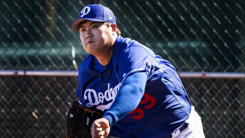 GLENDALE, AZ - FEBRUARY 19, 2019: Dodgers pitcher Hyun-Jin Ryu warms-up during spring training at