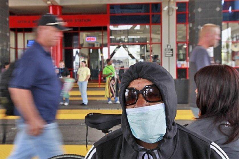 Lydia Garcia waited to board the trolley yesterday at Imperial  Avenue in San Diego. (John R. McCutchen / Union-Tribune)