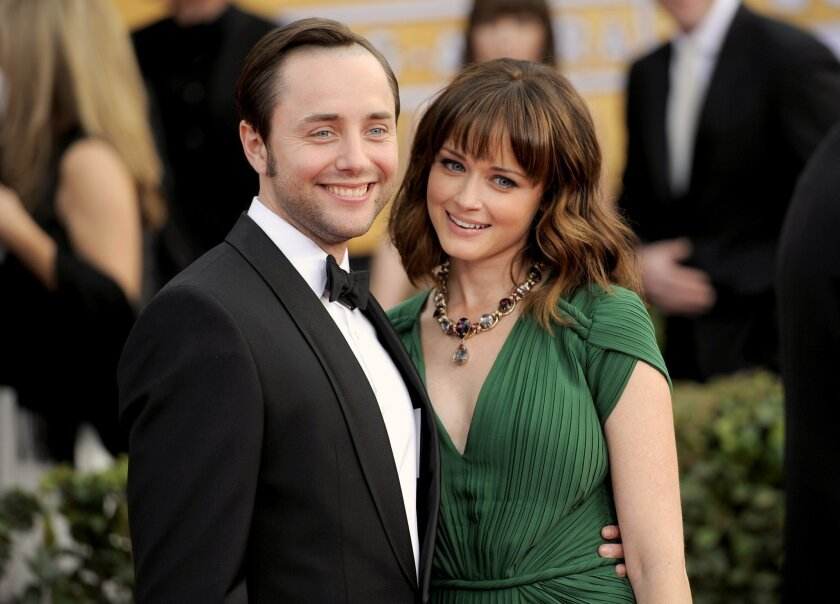 FILE - In this Jan. 27, 2013, file photo, actors Vincent Kartheiser, left, and Alexis Bledel pose at the 19th Annual Screen Actors Guild Awards at the Shrine Auditorium in Los Angeles. Representatives for both actors confirmed on May 19, 2016, that the couple welcomed a baby boy in the fall of 2015. (Photo by Chris Pizzello/Invision/AP, File)