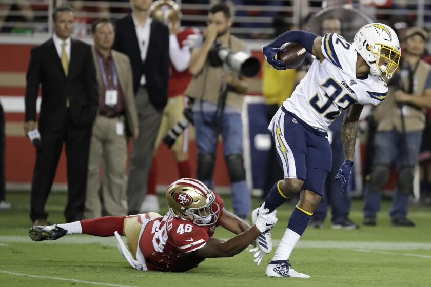 Chargers safety Nasir Adderley intercepts a pass in front of San Francisco 49ers' Tyree Mayfield during a preseason game.