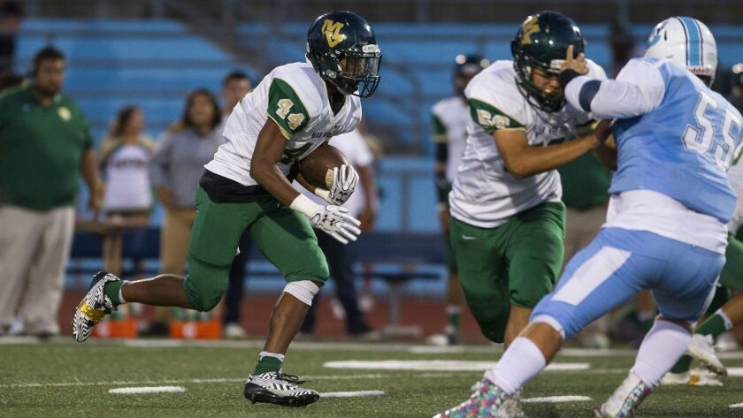 Mar Vista running back Hasan Spruill carries the ball during the first quarter.