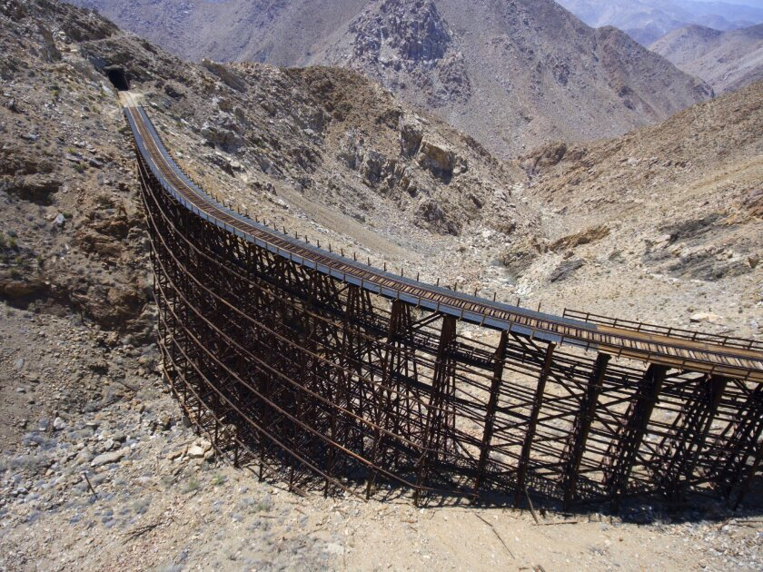 This part of the Desert Line, which runs between Campo and Plaster City, is called Goat Canyon Trestle. It is considered to be the tallest curved wooden trestle in the world.