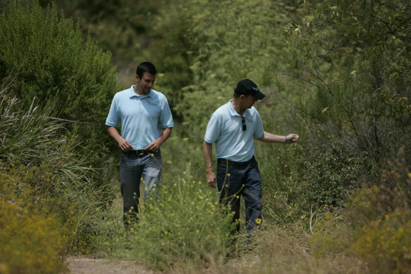 Will Anderson, left, and Eric Bowlby, right, stroll through Switzer Canyon in San Diego. Both are part of San Diego Canyonlands, a non-profit group that is ramping up efforts to secure nearly 11,000 acres of open spaces citywide.