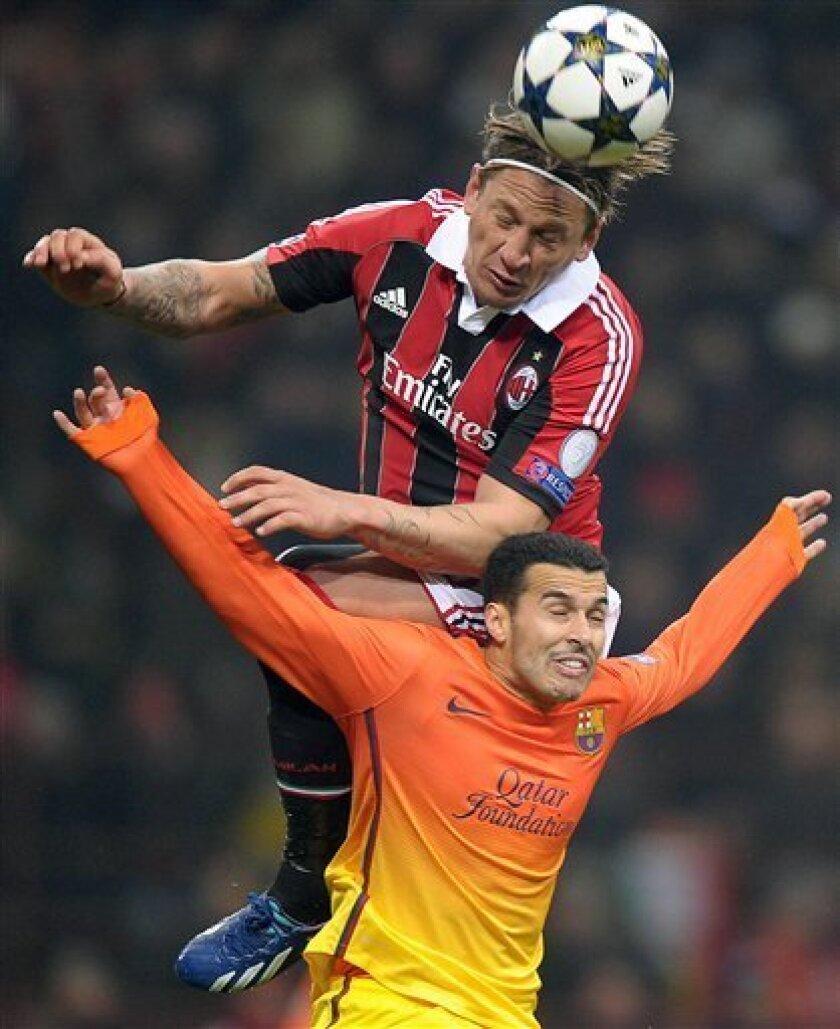 AC Milan defender Philippe Mexes jumps higher than Barcelona's Pedro during their Champions League round of 16, first leg soccer match, at the San Siro stadium in Milan, Italy, Wednesday, Feb. 20, 2013. AC Milan won 2-0. (AP Photo/Fabio Ferrari, Lapresse)