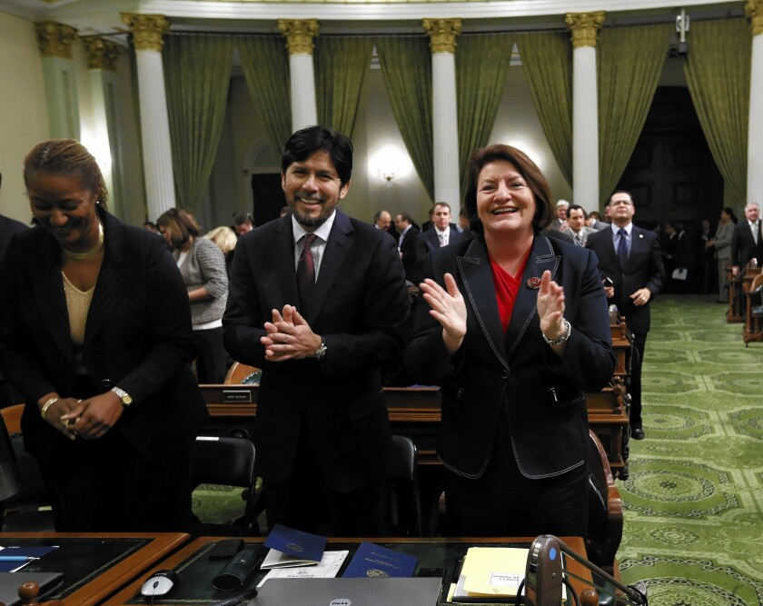 State Sen. Kevin de Leon (D-Los Angeles) and Assemblywoman Toni Atkins (D-San Diego) applaud Gov. Jerry Brown, before his annual State of the State address before a joint session of the Legislature at the Capitol oin Wednesday. Atkins will replace John A. Pérez as Assembly speaker later this year. De Leon will replace Darrell Steinberg (D-Sacramento) as Senate president pro tem.