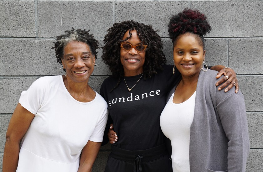 """Playwright Charlayne Woodard, center, with """"The Garden"""" cast, Stephanie Berry, left, and Monique Gaffney, right."""