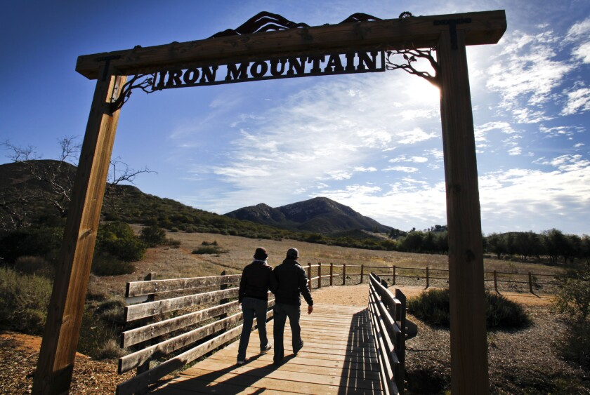 Hikers embark at the Iron Mountain Trail in East County. Howard Lipin • U-T