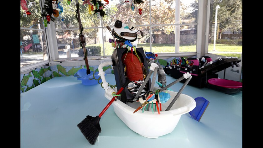 """Adams Hill resident and artist Cathy Hrenda's art piece '""""We're All In The Same Boat"""" is on display now at the Richfield Gas Station, Adams Square Mini Park, in Glendale on Tuesday, Nov. 28, 2017. Hrenda created her artwork from trash she fond throughout Glendale. Trash used includes a large picnic table umbrella, plastic tub, aluminum cans, bottles and other items."""
