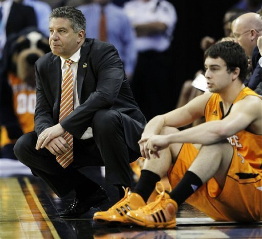 Tennessee head coach Bruce Pearl walks the sideline in the closing seconds of the second half of a West Regional NCAA tournament second round college basketball game against Michigan, Friday, March 18, 2011, in Charlotte, N.C. Michigan routed Tennessee 75-45, to send the Volunteers coach to an early offseason of uncertainty. (AP Photo/Bob Leverone)