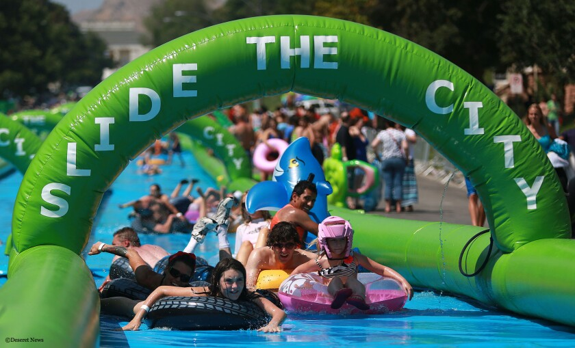 A giant water slide, like this one on Main Street in Salt Lake City, was proposed for downtown L.A., but organizers announced permits for the event were denied by the city.