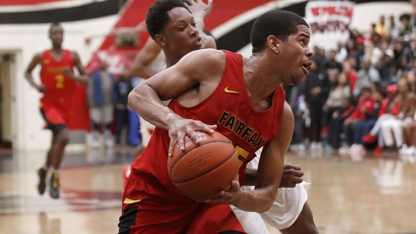 Fairfax guard Riobert McRae drives to the basket against Westchester guard Kevin Bethel in the first half Friday night,