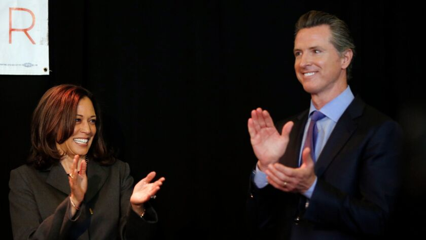 Sen. Kamala Harris, left, and Gov. Gavin Newsom.