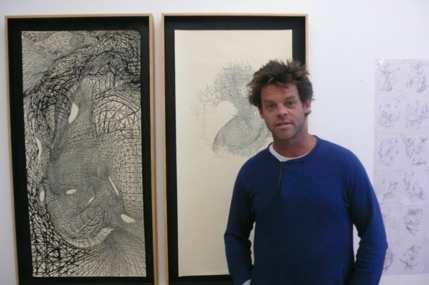 Patrick Shields with his fine-line drawings.