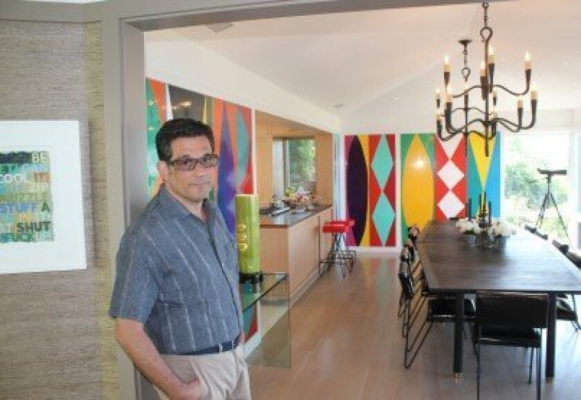 The kitchen of Georgis' La Jolla home features colorful panels commissioned San Diego artist Kim MacConnel.