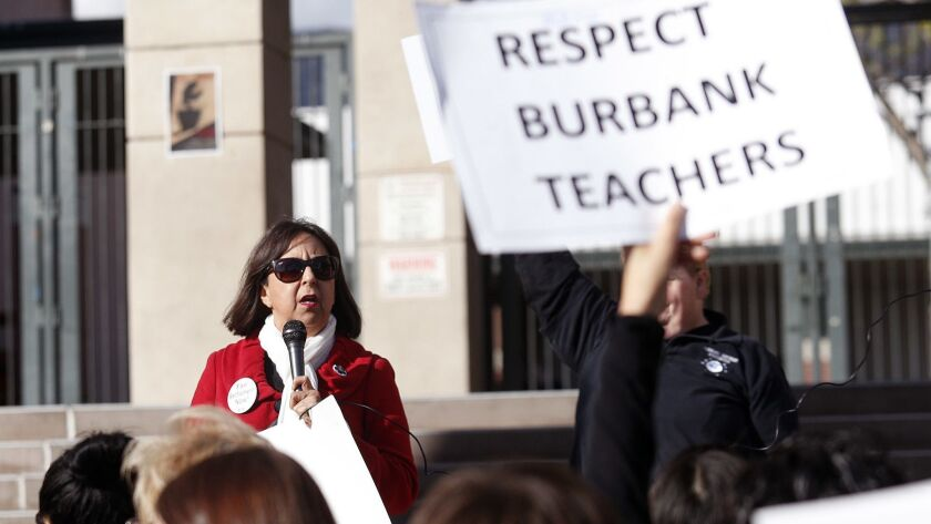 Burbank Teachers Association President Diana Abasta talks with the members who have gathered at Burb