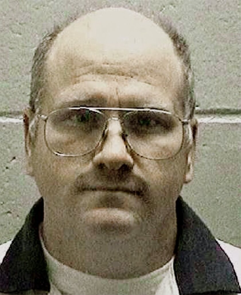 FILE -In this undated file photo released by the Georgia Department of Corrections shows death row inmate and former U.S. Navy sailor Travis Hittson in Georgia. Hittson, 45, is to scheduled be put to death Wednesday evening, Feb. 17, 2016. The 45-year-old inmate was convicted in the April 1992 kill