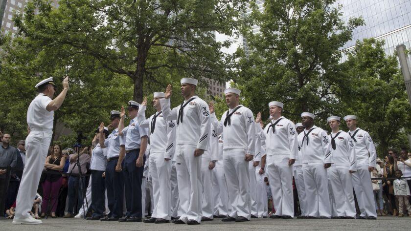 Adm. Phil Davidson, left, commander of the U.S. Fleet Forces Command/Naval Forces U.S. Northern Comm