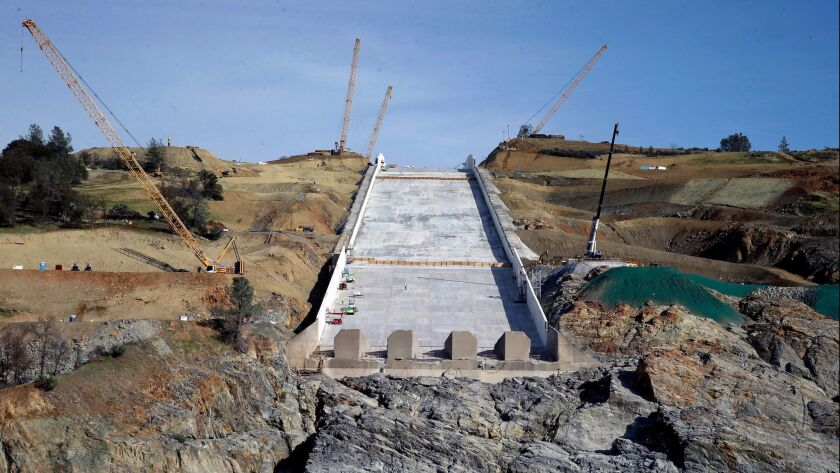 In this Nov. 30, photo, work is shown continuing on the Oroville Dam spillway in Oroville, Calif.