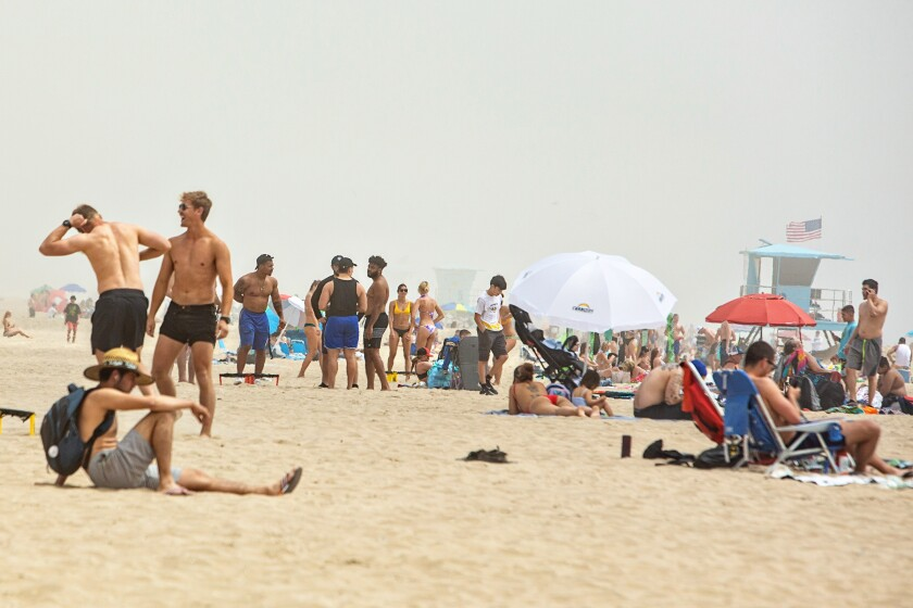 After being on lockdown for more than a month, people congregated Sunday at Huntington Beach.