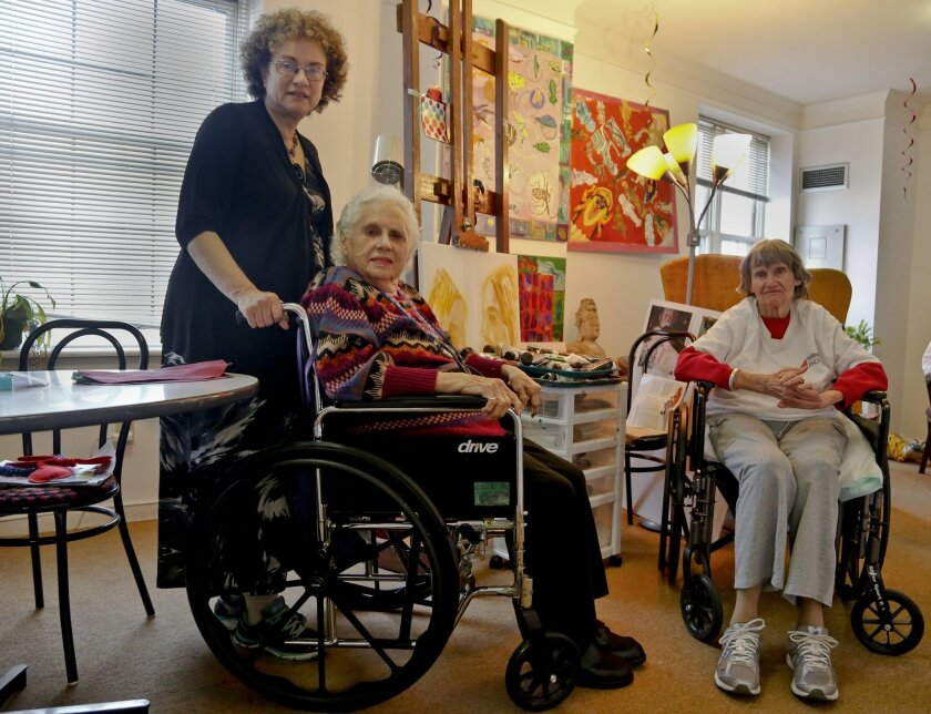 ADVANCE FOR USE SUNDAY, MAY 8, 2016 AND THEREAFTER - Alice Singer, center, an artist who is a resident of the assisted living apartments Prospect Park Residence, is visited by her daughter Joyce Singer, left, and her next-door neighbor, Annemarie Mogil, in the Brooklyn borough of New York on Thursd