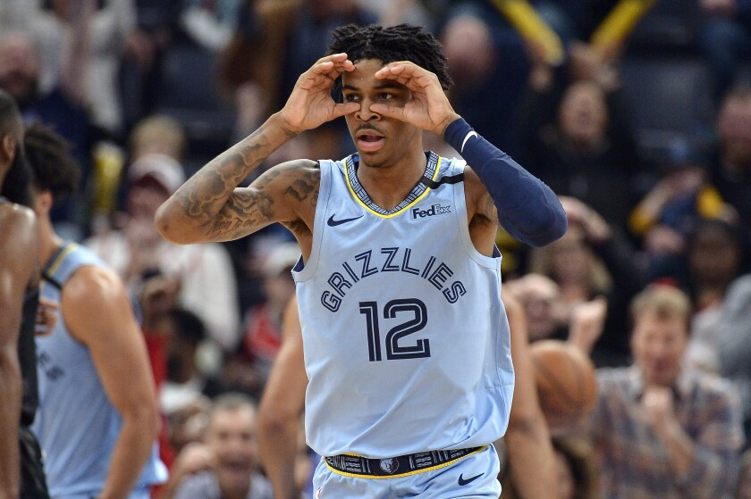 Memphis Grizzlies guard Ja Morant reacts after an assist in the first half of the team's NBA basketball game against the Houston Rockets on Tuesday, Jan. 14, 2020, in Memphis, Tenn. (AP Photo/Brandon Dill)