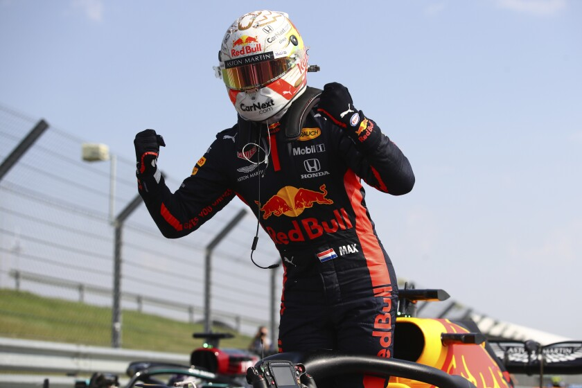 Max Verstappen celebrates after winning the 70th Anniversary Formula One Grand Prix.