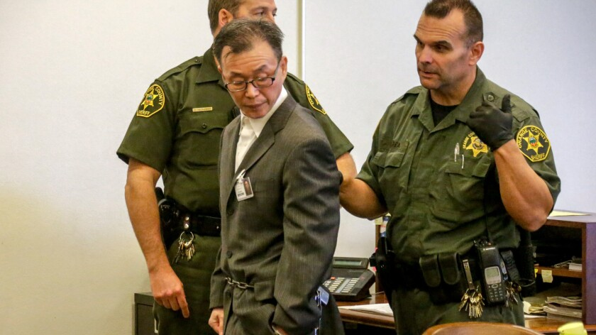 Beong Kwun Cho breaks down while addressing court at his sentencing hearing.