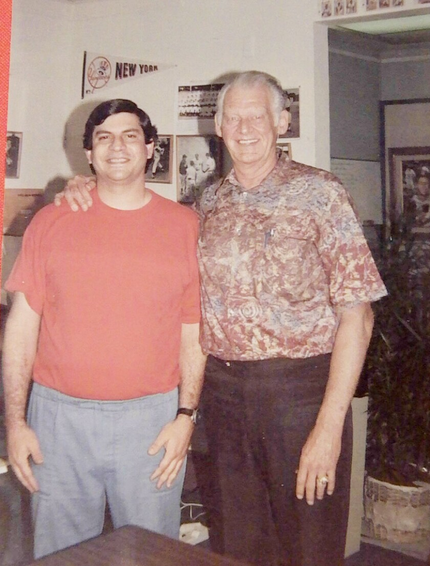 Fan Arthur Harutunian had his picture taken with Don Larsen when the perfect game pitcher made an appearance at a La Mesa baseball card shop in the 1990s.