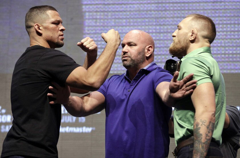 Dana White stands between Nate Diaz, left, and Conor McGregor during a July 7 news conference for UFC 202.