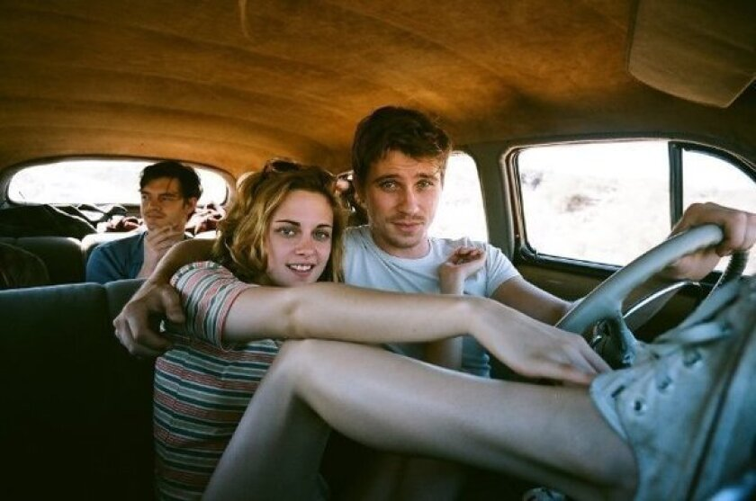 Kristen Stewart and Garret Hedlund in 'On the Road,' with Sam Riley in the back seat.
