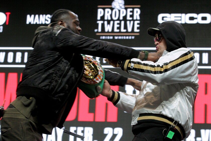 Deontay Wilder, left, and Tyson Fury get into an altercation during their news conference on Feb. 19, 2020, at MGM Grand Garden Arena in Las Vegas.