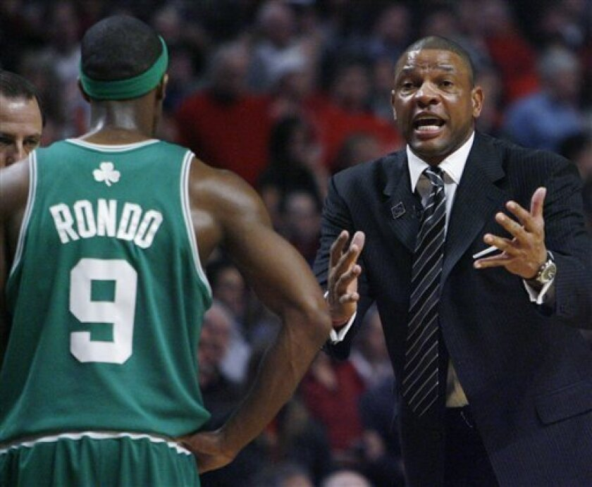 Boston Celtics coach Doc Rivers, right, yells to Boston's Rajon Rondo after Rondo's altercation with Chicago Bulls' Kirk Hinrich during the first quarter of Game 6 of a first-round NBA basketball playoff series in Chicago, Thursday, April 30, 2009. Rondo was assessed a flagrant foul and Hinrich a technical foul. (AP Photo/Nam Y. Huh)