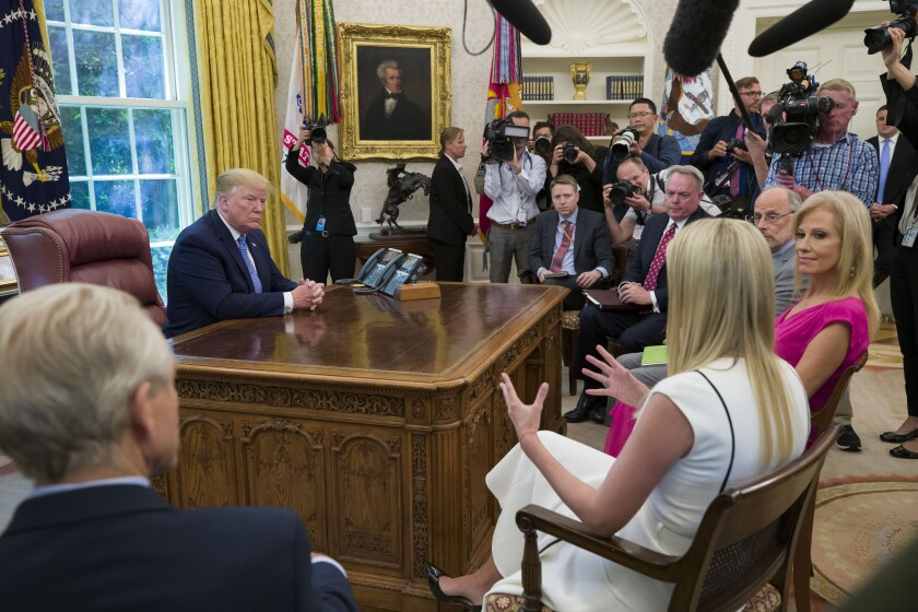 President Trump gets an update on the opioid crisis from his daughter Ivanka in the Oval Office on June 25, 2019.