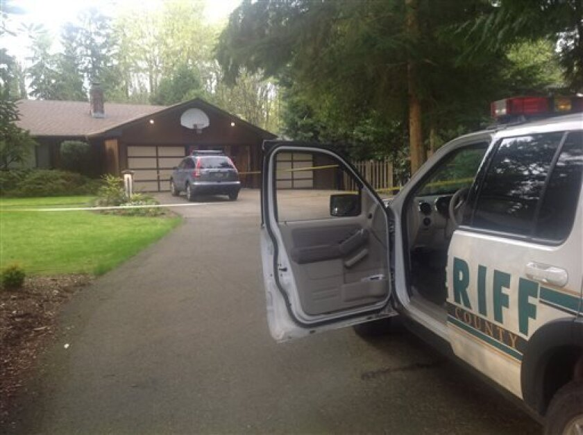 This photo provided by the King Co. Sheriff's Dept., shows a home, Saturday, April 27, 2013 in Woodinville, Wash. where detectives were investigating a homicide. The home is owned by the man who packed the parachutes used by infamous airplane hijacker D.B. Cooper more than four decades ago. The vic
