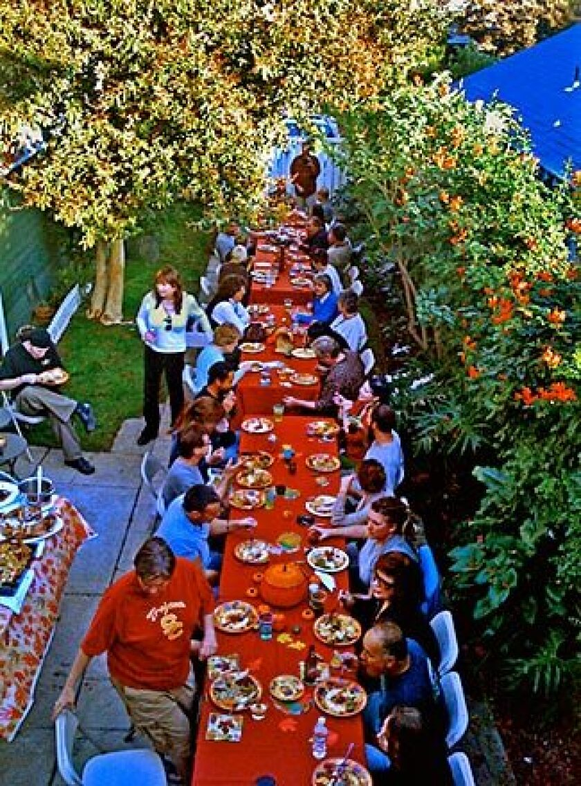 """Friends gather at the """"Long Table Thanksgiving,"""" which has grown over the years."""