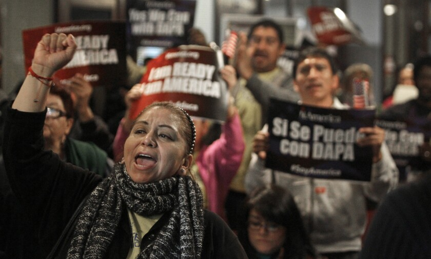 Mercedes Herrera and others chant during an event on DACA