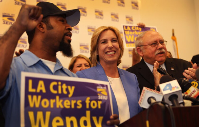Los Angeles City Controller and mayoral candidate Wendy Greuel, center, receives an endorsement from SEIU Local 721 at the union's headquarters downtown. Now Greuel is in line to receive an endorsement from the powerful L.A. County Federation of Labor.