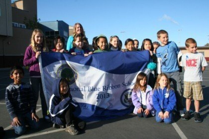 Students show off the Blue Ribbon flag.