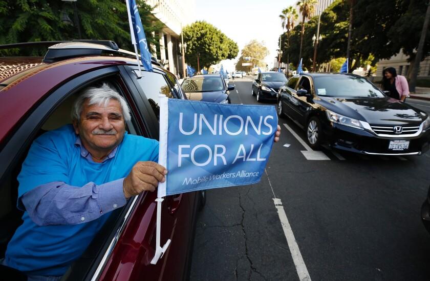 la-photos-1staff-469109-la-me-uber-lyft-minimum-wage-debate-2-als-230539589