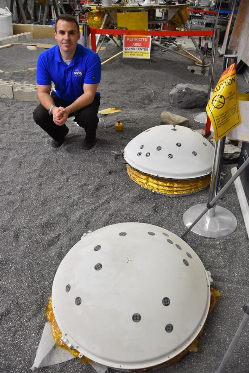 Spain's Fernando Abilleira, the assistant director for design and navigation for the InSight space probe project to explore Mars and part of the multidisciplinary and international mission team, poses with a replica of the spacecraft in Pasadena, California, on Nov. 25, 2018. EFE-EPA/ Ivan Mejia