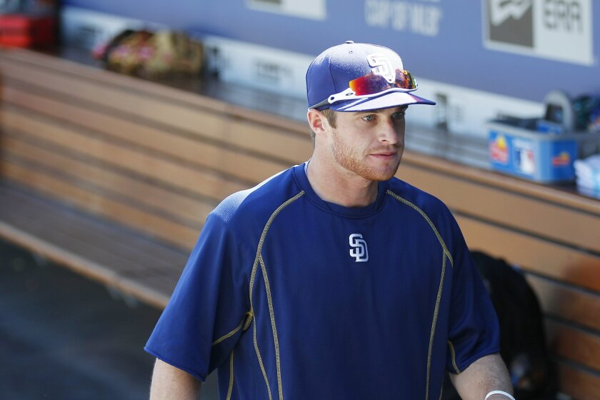Padres Cory Spangenberg heads to  batting practice at Dodger Stadium before opening day.