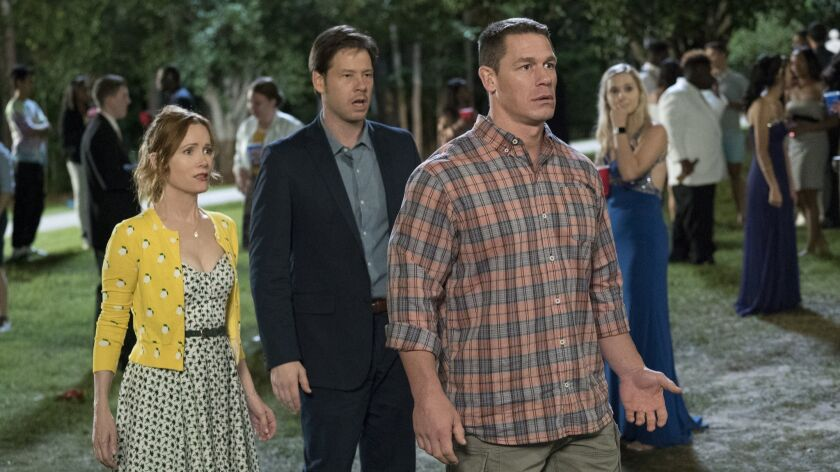 "Leslie Mann, Ike Barinholtz, center, and John Cena in a scene from the movie ""Blockers."""