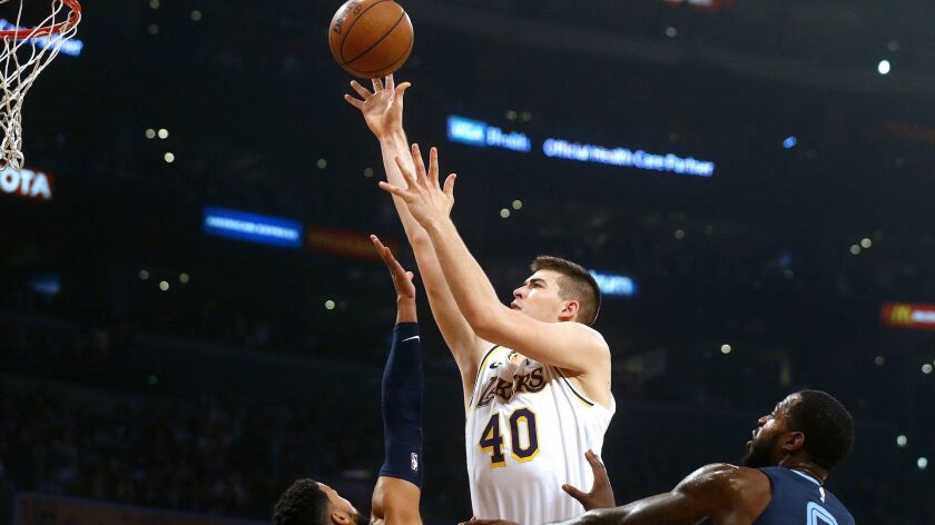 Lakers center Ivica Zubac attempts a shot over Grizzlies forward JaMychal Green, left, and guard Garrett Temple during the first half Sunday.