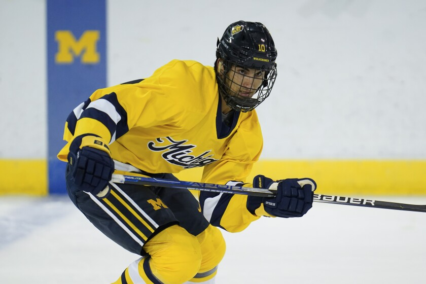 University of Michigan center Matty Beniers (10) skates during an NCAA college hockey practice in Ann Arbor, Mich., Wednesday, Sept. 22, 2021. A majority of the 2021 NHL draft class elected to spend one more season developing before making the jump to the world's top hockey league. The expansion Seattle Kraken took Matt Beniers No. 2 overall. (AP Photo/Paul Sancya)