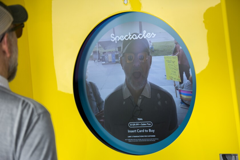 Passersby can stand in front of kiosks at the Snapchat Spectacles store and see themselves with the glasses projected onto their image, along Ocean Front Walk in Venice.