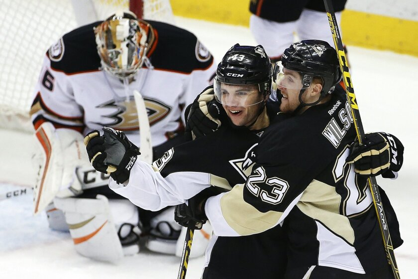 Pittsburgh Penguins' Conor Sheary (43) celebrates his goal with teammate Scott Wilson (23) in front of Anaheim Ducks goalie John Gibson (36) during the first period of an NHL hockey game against the Anaheim Ducks in Pittsburgh, Monday, Feb. 8, 2016. (AP Photo/Gene J. Puskar)